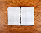 Notepad with a spiral binding and checkered sheets