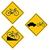 Three yellow bicycle signs