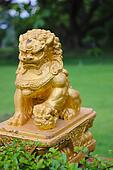 Gold lion statue front the grass