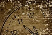 old wall with clock sin