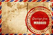 Greetings from madrid, red grunge stamp on an airmail background