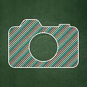Travel concept: Photo Camera on chalkboard background