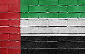 Flag of United Arab Emirates on brick wall