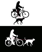 Women on bicycle with dogs on leash