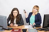 Positive girl in the office with a phone in his hand close to the negative counterpart