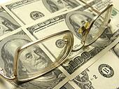 close-up of dollars and eyeglasses