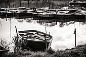 Boat Harbour - in black and white wood boats on the lake