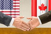 Representatives of the USA and Canada shake hands
