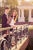 Young fashion elegant stylish coupl ein love posing on the bridge lovers. Hipster cute girl with handsome man having fun outdoor.