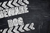 Chalkboard writing: Beware of dog sign