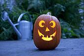 Illuminated Halloween pumpkin in the garden