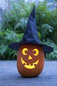 Illuminated Halloween pumkin with black hat