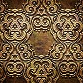 Gold metal pattern on paper backgrond (vintage collection)