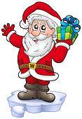 Santa with Christmas gift on iceberg