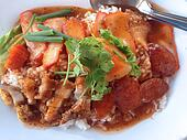 serving of rice with roasted pork on top