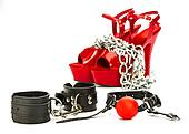Fetish stuff: hand cuffs, mask, whip and extreme high heels shoe
