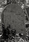 stone tombstone in black and white