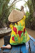 Vietnam woman rows a boat, Mekong