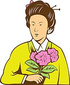 Japanese woman in kimono holding flowers
