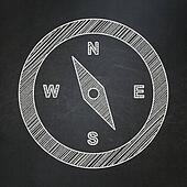 Tourism concept: Compass on chalkboard background