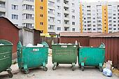 new building with garbage containers and garages