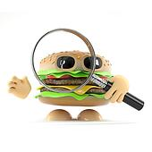 3d Beefburger looks through a magnifying glass
