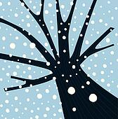 Winter tree with falling snow
