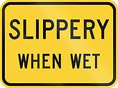 United States MUTCD road sign - Slippery when wet