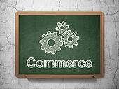 Finance concept: Gears and Commerce on chalkboard background