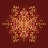 Golden detailed snowflake on red background