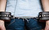 Arrest. Leather handcuffs on hands prisoner girl