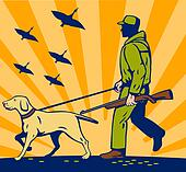 Hunter with rifle walking with trained hunting gun dog