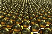 Hundreds of golden golf balls lined up on a mirror