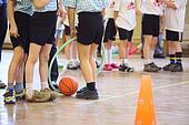 Children's feet in sports hall