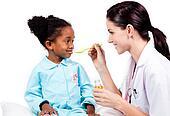 Sick little girl taking medicine against