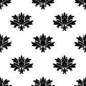 Black silhouette foliate motif in a seamless pattern