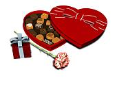 Heart shaped chocolate box, present and carnation.