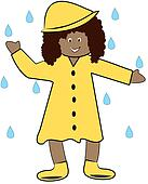 ethnic girl in rain coat playing in the rain