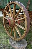 An old wooden wagon wheel.