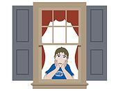 Sad boy leaning in window sill