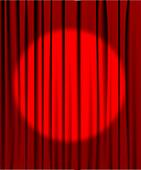 Curtain from the theatre with a spotlight