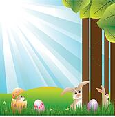Easter holiday hares on blue light burst background