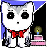 cat standing near a birthday cake