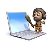3d Caveman standing on a laptop pc
