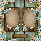 Blue wooden background with 2 vintage frames, flowers, pearls an