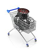 The car rims in shopping cart, isolated on white background