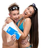 Half-length portrait of half-naked couple with travel tickets