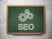 Web design concept: Gears and SEO on chalkboard background