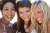 Three Beautiful Young Women Friends Laughing At The Beach