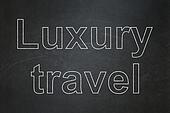 Travel concept: Luxury Travel on chalkboard background